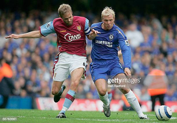 Olof Mellberg of Aston Villa battles with Eidur Gudjohnsen of Chelsea during the Barclays Premiership match between Chelsea and Aston Villa at...