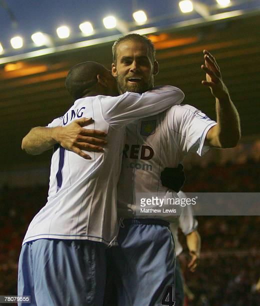 Olof Mellberg of Aston Villa celebrates his goal with Ashley Young during the Barclays Premier League match between Middlesbrough and Aston Villa at...