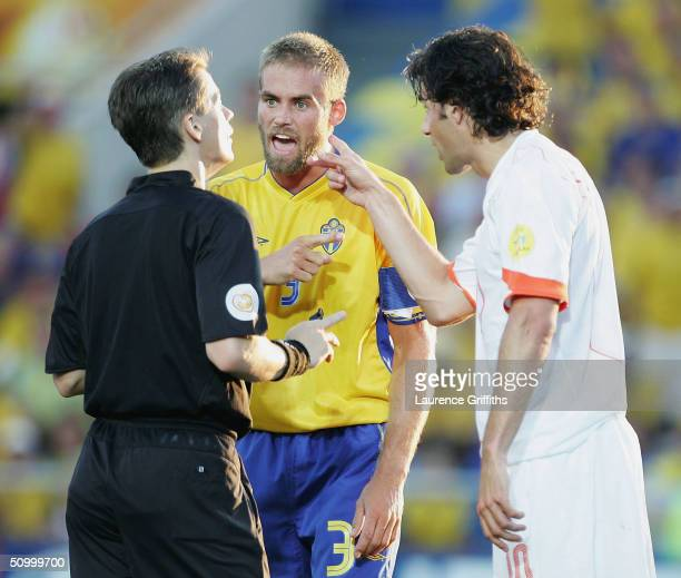 Olof Mellberg of Sweden and Ruud Van Nistelrooy of Holland argue with the referee during the UEFA Euro 2004, Quarter Final match between Sweden and...
