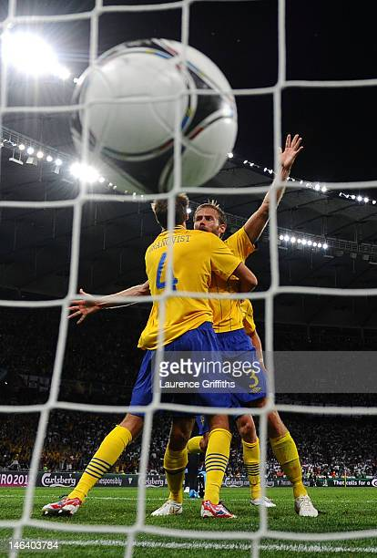 Olof Mellberg of Sweden celebrates scoring their second goal with with Andreas Granqvist of Sweden during the UEFA EURO 2012 group D match between...
