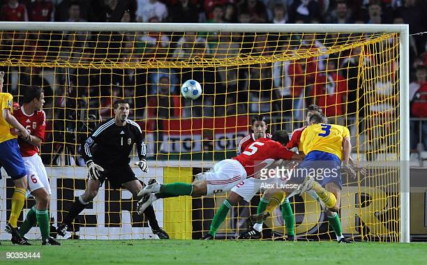 Olof Mellberg of Sweden scores the opening goal during the FIFA2010 World Cup Qualifier match between Hungary and Sweden at the Ferenc Puskas Stadium...