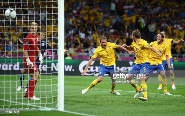 Olof Mellberg of Sweden scores their second goal during the UEFA EURO 2012 group D match between Sweden and England at The Olympic Stadium on June...