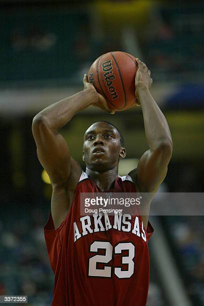 Olu Famutimi of the University of Arkansas Razorbacks shoots a free throw during the first round of the SEC Men's Basketball Tournament against the...