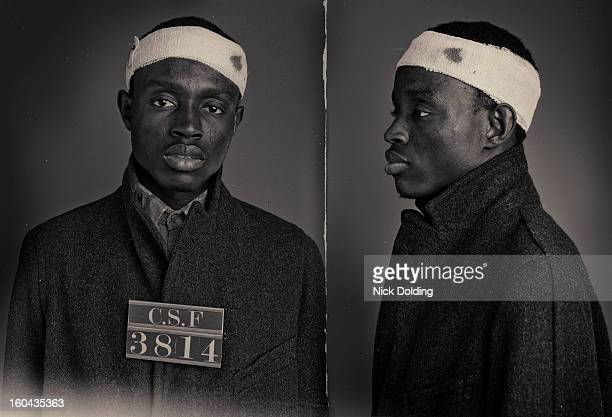 olu wanted mugshot - overcoat stock pictures, royalty-free photos & images