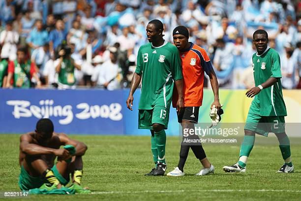 Olubayo Adefemi Ambrose Vanzekin and Chibuzor Okonkwo of Nigeria look dejected after the Men's Gold Medal football match between Nigeria and...