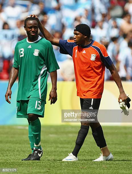 Olubayo Adefemi and Ambrose Vanzekin of Nigeria look dejected after the Men's Gold Medal football match between Nigeria and Argentina at the National...
