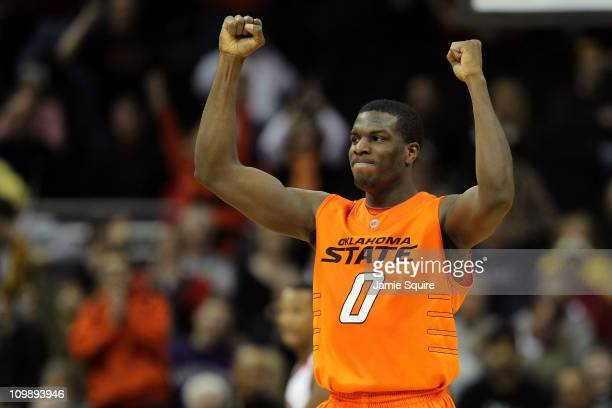 P Olukemi of the Oklahoma State Cowboys reacts after defeating the Nebraska Cornhuskers 5352 in the first round of the 2011 Phillips 66 Big 12 Men's...