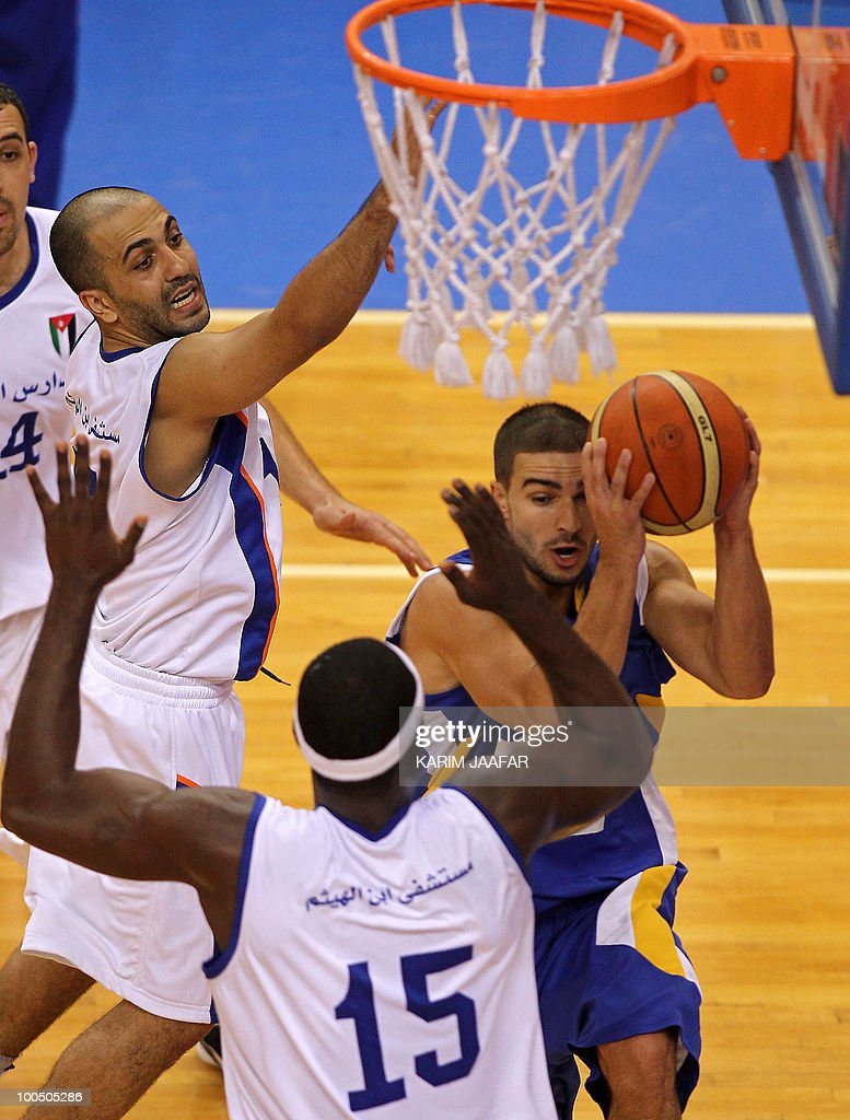 Olumide Oyedeji (foreground) and Wissam al-Sus (L) of Jordan's ASU club challenge by Ali Mahmud of Lebanon's Al-Riyadi during their 21st FIBA Asia Champions Cup basketball match at Al-Gharafa Indoor Stadium in Doha on May 25, 2010.