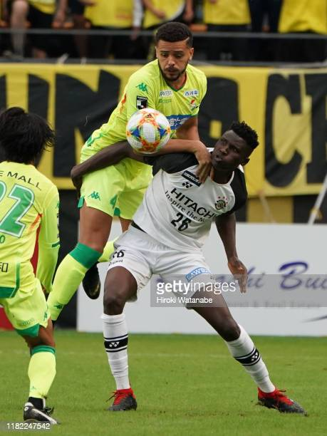 Olunga of Kashiwa Reysol and Hebert of JEF United Chiba compete for the ball during the J.League J2 match between JEF United Chiba and Kashiwa Reysol...