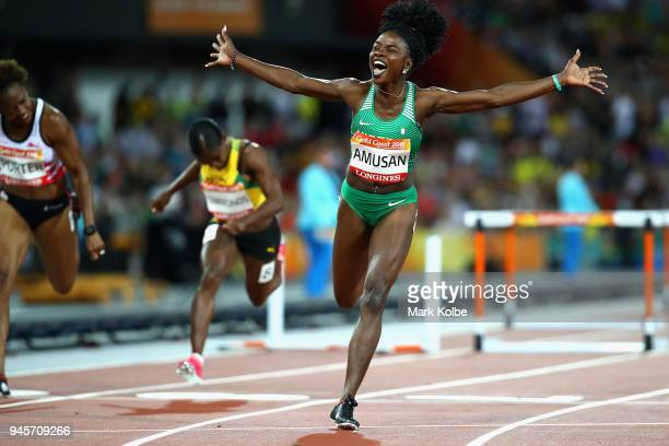 Oluwatobiloba Amusan of Nigeria celebrates as she crosses the line to win gold competes in the Women's 100 metres hurdles final during athletics on...