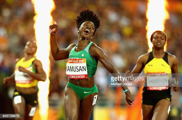 Oluwatobiloba Amusan of Nigeria celebrates as she crosses the line to win gold in the Women's 100 metres hurdles final during athletics on day nine...