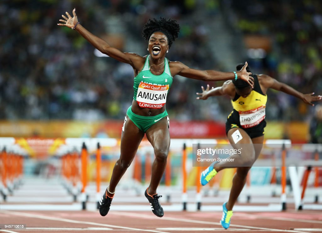 Oluwatobiloba Amusan of Nigeria celebrates as she crosses the line to win gold in the Women's 100 metres hurdles final during athletics on day nine of the Gold Coast 2018 Commonwealth Games at Carrara Stadium on April 13, 2018 on the Gold Coast, Australia.