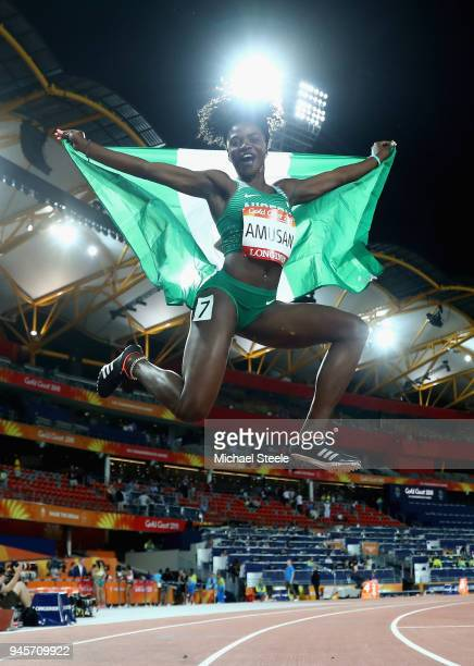 Oluwatobiloba Amusan of Nigeria celebrates winning gold in the Women's 100 metres hurdles final during athletics on day nine of the Gold Coast 2018...