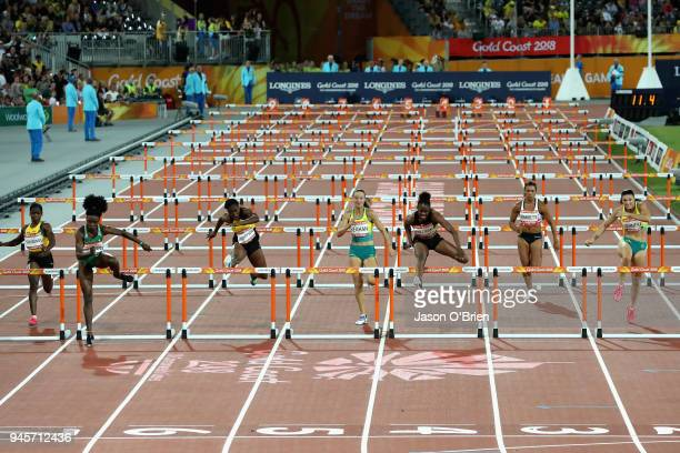Oluwatobiloba Amusan of Nigeria clears the final hurdles as she races to the line to win gold in the Women's 100 metres hurdles final during...