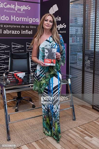 Olvido Hormigos signing books in the center El Corte Ingles PreciadosCallao Shopping Center in Madrid