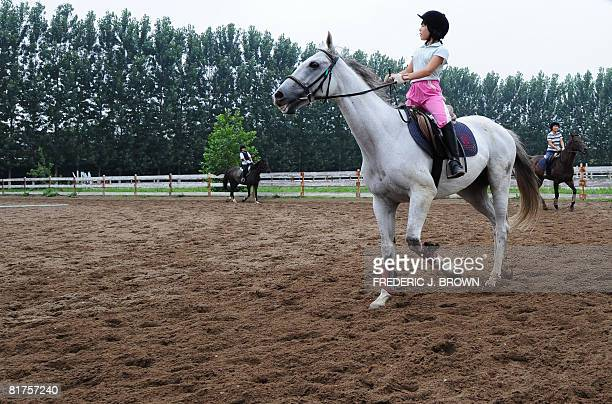 """Oly-2008-CHN-equestrian"""" by Fancois Bougon Riders and their horses at an equestrian club in Shunyi, on the outskirts of Beijing on June 28, 2008...."""