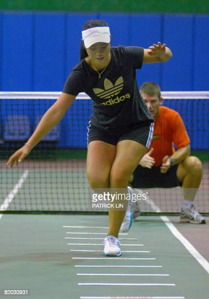Oly2008tennisTPEChanFEATURE by Amber Wang Taiwan's top tennis player Chan YungJan takes part in a training session in Taipei on July 13 2008 as she...