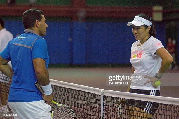 Oly2008tennisTPEChanFEATURE by Amber Wang Taiwan's top tennis player Chan YungJan chats with her coach during a training session in Taipei on July 13...