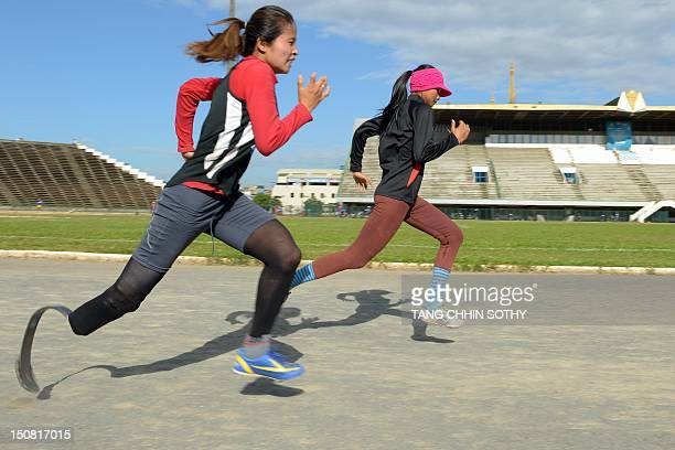 Oly2012ParalympicsCAMFOCUS by Bunthoeun Chea This photo taken on August 14 2012 shows Thin Seng Hon running during a training session at the national...