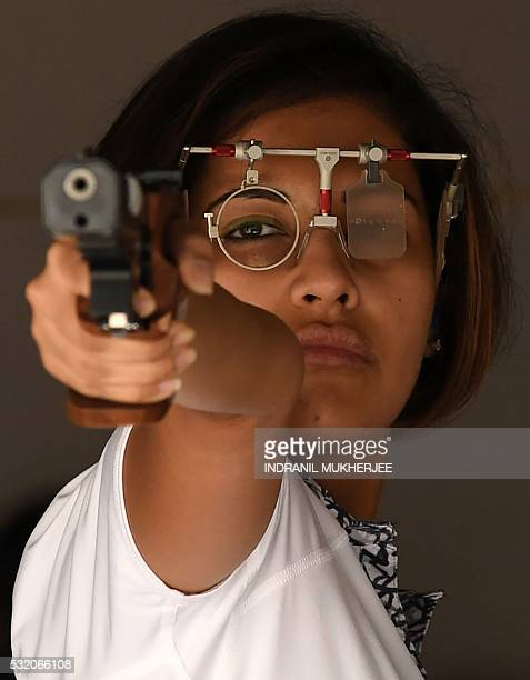 WITH 'OLY2016INDshooting' INTERVIEW by Peter HUTCHISON In this photograph taken on April 25 Indian shooter Heena Sidhu lines up a shot as she takes...