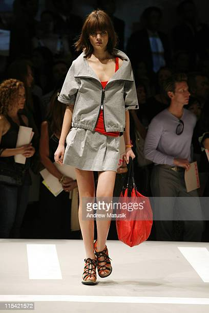 Olya Ivanisevic wearing DKNY Spring 2007 during Olympus Fashion Week Spring 2007 DKNY Runway at 711 Greenwich Street in New York City New York United...