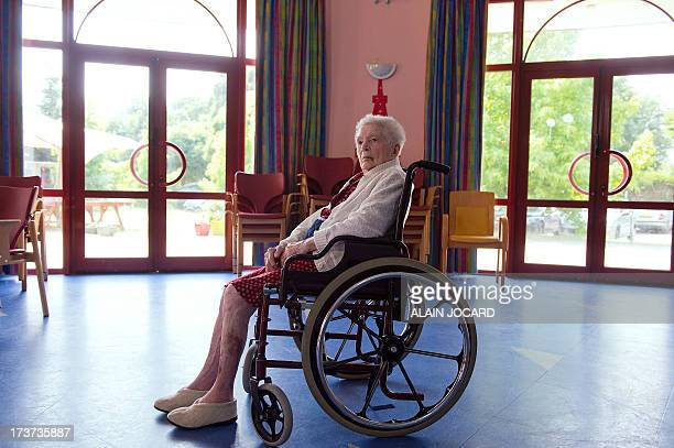 Olympe Amaury 112 years old the oldest 'known' person living in France poses on July 17 2013 in Amilly near Montargis central France AFP PHOTO/ ALAIN...