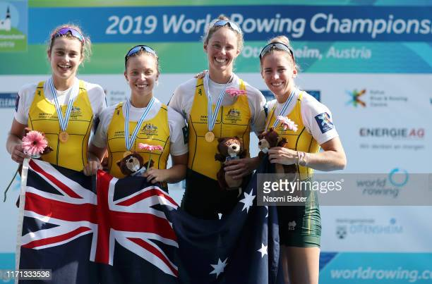 Olympia Aldersey, Katrina Werry, Sarah Hawe and Lucy Stephan of Australia pose for a photograph during the victory ceremony after winning the Gold...