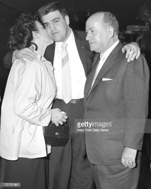 Olympia kisses husband Vincent Gigante after his acquittal on charges of attepted murder of Frank Costello. Maurice Edelbaum his lawyer stands by.