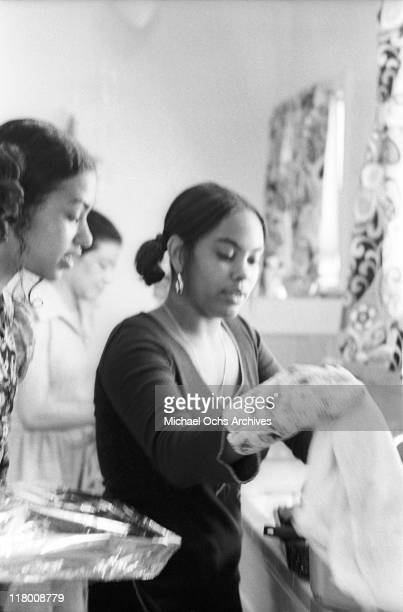 Olympia Sylvers and Charmaine Sylvers of the R and B group The Sylvers helps make lunch at home on June 29 1972 in Los Angeles California