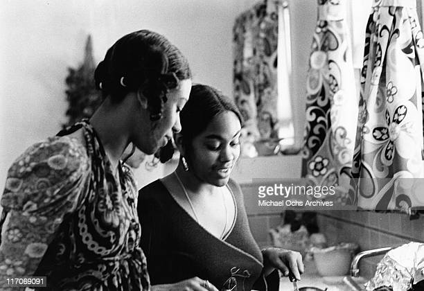 Olympia Sylvers and Charmaine Sylvers of the R and B group The Sylvers in the kitchen of their home on June 29 1972 in Los Angeles California