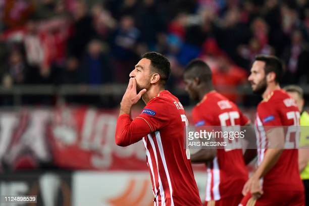 Olympiacos Ahmed Hassan celebrates with teammates after scoring during the UEFA Europa League round of 32 first leg football match between Olympiacos...
