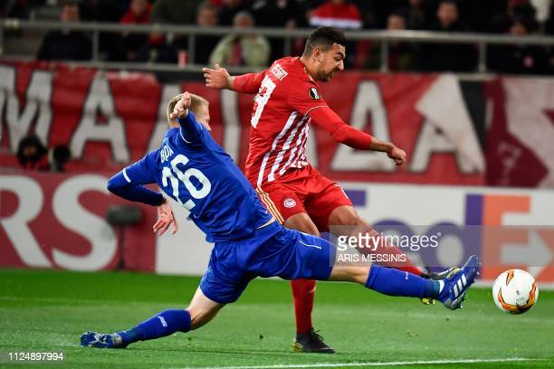 Olympiacos Ahmed Hassan scores a goal past Dynamo's Mykyta Burda during the UEFA Europa League round of 32 first leg football match between...