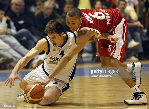 Olympiacos Athens player Alex Acker right fights for the ball with Milenko Tepic left from Partizan during the TOP 16 group E Euroleague basketball...