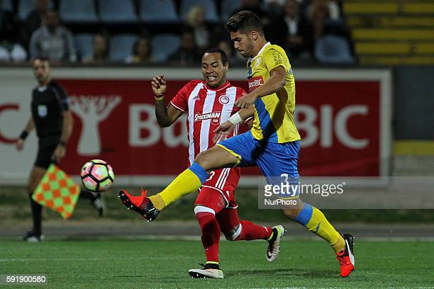 Olympiaco's Colombian forward Felipe Pardo with Arouca's Portuguese defender Hugo Bastos in action during the UEFA Europa League 2016/17 match...