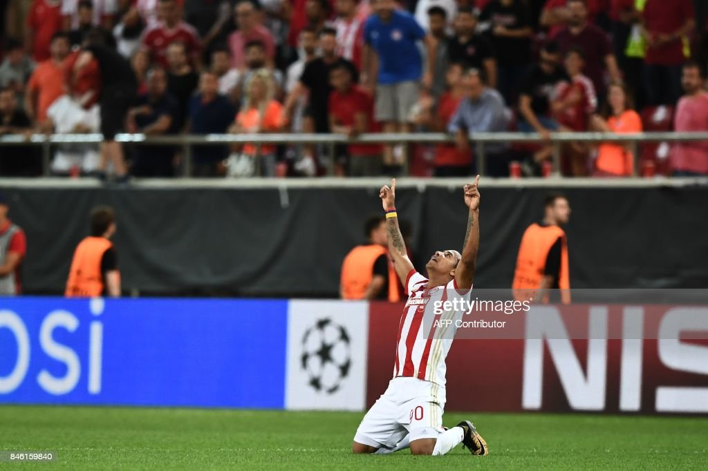 Olympiacos' Colombian midfielder Felipe Pardo celebrates after scoring during the UEFA Champions League Group D football match between Olympiacos Piraeus FC and Sporting Lisbon on September 12, 2017 at the Karaiskaki stadium in Athens. /