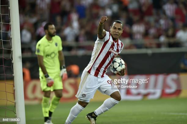 Olympiacos' Colombian midfielder Felipe Pardo celebrates his first goal during the Group D UEFA Champions League football match between Olympiacos...