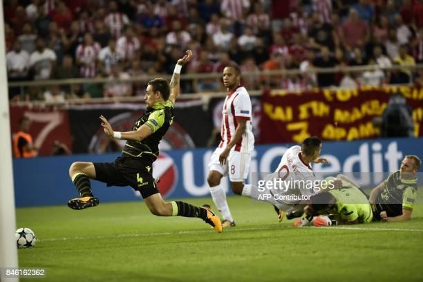 Olympiacos' Colombian midfielder Felipe Pardo scores a goasl despite Sporting Lisbon's Uruguayan defender Sebastian Coates during the UEFA Champions...