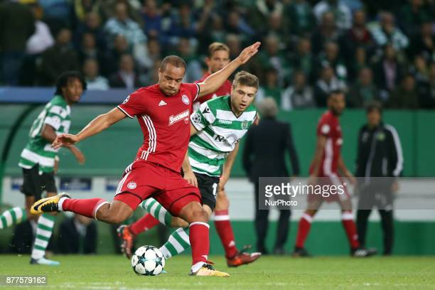Olympiacos' Colombian midfielder Felipe Pardo vies with Sporting's defender Stefan Ristovsk from Macedonia during the UEFA Champions League group D...