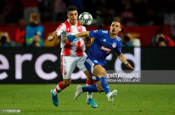 Olympiacos' Daniel Podence vies with Red Star's Mateo Garcia during the UEFA Champions League Group B football match between Red Star Belgrade and...