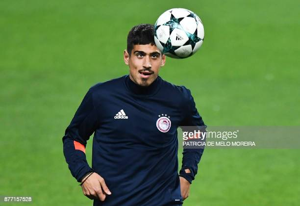 Olympiacos' defender Dimitris Nikolaou heads the ball during a training session at Alvalade stadium in Lisbon on November 21 2017 on the eve of the...