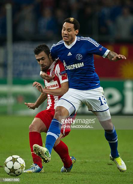 Olympiacos defender Giannis Maniatis and Schalke's US midfielder Jermaine Jones vie for the ball during the UEFA Champions League Group B football...