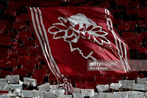 Olympiacos' fans cheer during the Group A Champions League football match Olympiacos vs Juventus at the Karaiskaki stadium in Athens' Piraeus...