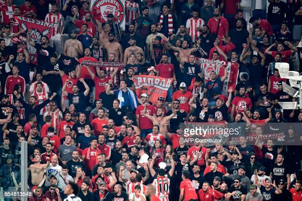 Olympiacos fans cheer during the UEFA Champion's League Group D football match Juventus vs Olympiacos on September 27 2017 at the Juventus stadium in...