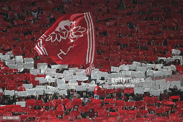 Olympiacos' fans cheer their team during the UEFA Champions League Group A soccer match between Olympiacos FC and Juventus at Georgios Karaiskakis...