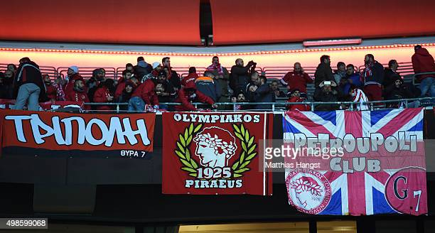 Olympiacos fans hang their banners and flags prior to kickoff during the UEFA Champions League group F match between FC Bayern Munchen and Olympiacos...