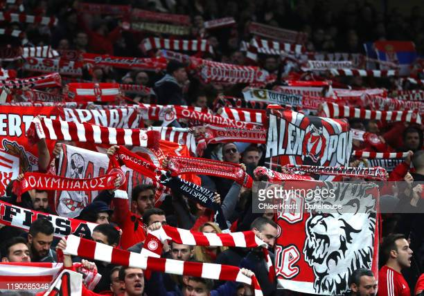 Olympiacos fans hold up flags during the UEFA Champions League group B match between Tottenham Hotspur and Olympiacos FC at Tottenham Hotspur Stadium...