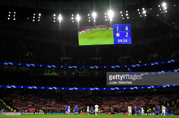 Olympiacos fans hold up scarves during the UEFA Champions League group B match between Tottenham Hotspur and Olympiacos FC at Tottenham Hotspur...