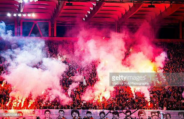 Olympiacos fans light up flares as teams hold a minute of silence for the victims of the 1981 tragedy at the old Karaiskaki stadium taking lifes of...