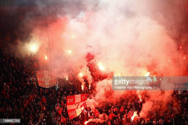 Olympiacos fans light up signal flares ahead of the Superleague match between Olympiacos Piraeus and AEK Athens at Karaiskakis Stadium on February 10...