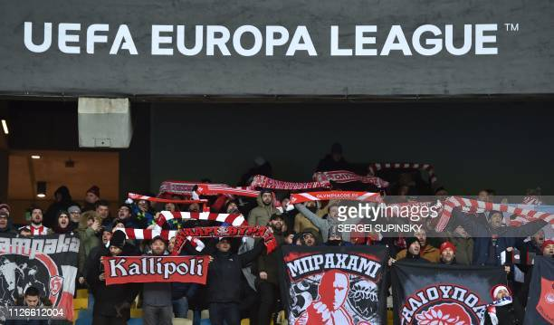 Olympiacos fans react during the UEFA Europa League round of 32 second leg football match between FC Dynamo Kyiv and Olympiacos FC at Olympiyski...